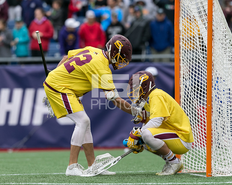 Foxborough, Massachusetts - May 27, 2018: NCAA Division III tournament final. Wesleyan University (red) defeated Salisbury University (yellow), 8-6, at Gillette Stadium.<br /> Anthony Stavrakis consoles Brandon Warren.