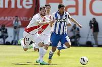Rayo Vallecano's Javi Fuego (l) and Jose Carlos Fernandez (c) and Real Sociedad's Carlos Vela during La Liga match.April 14,2013. (ALTERPHOTOS/Acero)