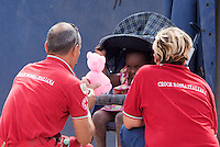 Operatori della Croce Rossa giocano con una bambina nella tendopoli allestita presso la stazione Tiburtina a Roma, 16 giugno 2015.<br /> Health workers of the Italian Red Cross play with a child in the tent camp set up near the Tiburtina railway station in Rome, 16 June 2015. Italy is facing a huge flow of migrants brought to Sicily after rescue at sea, many of whom are trying to join their relatives in northern Europe. <br /> UPDATE IMAGES PRESS/Riccardo De Luca