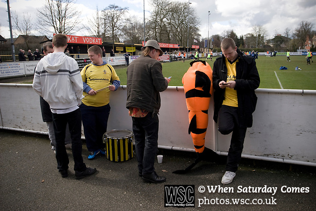 Southport fans waiting for the kick-off of their team's match against Harrogate Town at Wetherby Road, Harrogate. The Conference North match was won 3-2 by Southport, a result which kept the Sandgrounders on course for top spot in the division while Harrogate Town remained bottom.