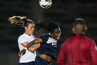 Seattle Reign FC defender Kate Deines (4) goes up for a header with Sky Blue FC forward Danesha Adams (9). Sky Blue FC defeated the Seattle Reign FC 2-0 during a National Women's Soccer League (NWSL) match at Yurcak Field in Piscataway, NJ, on May 11, 2013.