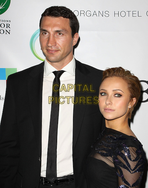 WLADIMIR KLITSCHKO & HAYDEN PANETTIERE.40th Annivesary of Earth Day held At The JW Marriott LA Live, Los Angeles, California, USA, 22nd April 2010..half length couple black suit tie white shirt tall short hair up sheer mesh see through thru dress sequined sequin .CAP/ADM/KB.©Kevan Brooks/AdMedia/Capital Pictures.