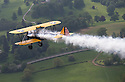 30/05/16<br /> <br /> Practicing for a 100 mph low-level air display to mark the Queen&rsquo;s 90th birthday Cliff Crozier sits in a vintage biplane, waving enthusiastically as smoke fills the cockpit.<br /> <br /> Surely this must make Cliff, who turned one hundred last year, one of the most spritely centenarians in Britain?<br /> <br /> Full story here: http://www.fstoppress.com/articles/2016/05/30/cliff_crozier_boeing_stearman/<br /> <br /> .Cliff&rsquo;s nieces bought him a flight in a Tiger Moth, similar to the one he first flew in in 1942, and yesterday he took to the skies above Derbyshire taking the controls for 15 minutes.<br /> <br /> After landing at Darley Moor Airfield near Ashbourne, Cliff hopped out of the Tiger Moth and beaming from ear to ear, said: &ldquo;It brought back more than a few memories - it was very exciting - not like flying in a modern aircraft&rdquo;.<br /> <br /> Will Flanagan, Chief Flying Instructor at Blue Eye Aviation said: &ldquo;He&rsquo;s the oldest passenger we&rsquo;ve ever had. Many elderly people need to be lifted in and out of the cockpit but Cliff climbed in and out, almost without any help at all. You&rsquo;d never believe he&rsquo;s a hundred&rdquo;<br /> <br /> All Rights Reserved, F Stop Press Ltd. +44 (0)1335 418365