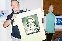 "Volunteer Peter Medvin, 60, of Miami, displays a shirt reading ""Yaaaas, Hillary!"" that he purchased as a campaign donation at the campaign office of Democratic presidential nominee Hillary Clinton in the Wynwood Arts District of Miami, Florida."