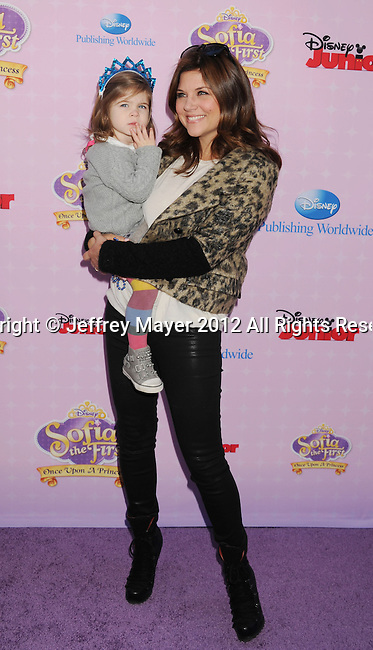 "BURBANK, CA - NOVEMBER 10: Tiffani Thiessen and daughter arrive at the Disney Channel's Premiere Party For ""Sofia The First: Once Upon A Princess"" at the Walt Disney Studios on November 10, 2012 in Burbank, California."