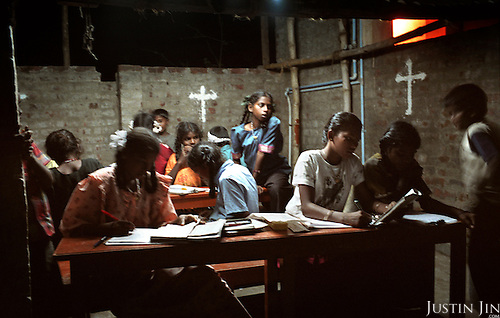 Children orphaned by the tsunami do their homework at an orphanage in Nagappattinam, on the southeastern coast of India. .The December 26, 2004 tsunami killed thousands of people along this coast, smashing boats, roads and houses and tearing thousands of families apart. .Picture taken February 2005 in Nagapptinam, Tamil Nadu, India, by Justin Jin