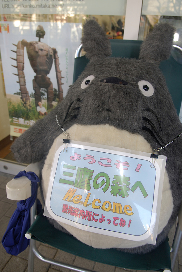 A Totoro soft toy outside the Mitaka tourist information office. The Totoro is a character from Miyazaki's My Neighbor Totoro. The Ghibli Museum in Mitaka, western Tokyo opened in 2001. It was designed by animator Miyazaki Hayao and receives around 650,500 visitors each year.