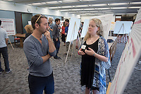 "Susan Burke '18 talks to faculty mentor John McCormack about ""Knocking out functionality of the microtubule-severing protein katanin in C. elegans neurons""<br /> Occidental College's Undergraduate Research Center hosts their annual Summer Research Conference on Aug. 4, 2016. Student researchers presented their work as either oral or poster presentations at the final conference. The program lasts 10 weeks and involves independent research in all departments.<br /> (Photo by Marc Campos, Occidental College Photographer)"