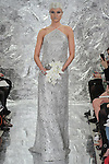 Model walks runway in Arden - a solar sail halter bridal gown with silver metal embroidery from, the Theia Spring 2017 bridal collection by Don O'Neill, during New York Bridal Fashion Week Spring Summer 2017 on April 14, 2016.