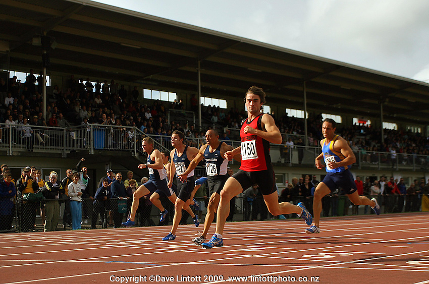Canterbury's David Ambler crosses the line first in the men's 100m final during the National athletics championships at Newtown Park, Wellington, New Zealand on Friday, 27 March 2009. Photo: Dave Lintott / lintottphoto.co.nz