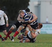 4th January 2014; Aaron Coneelly, Corinthians, is tackled by Andrew Kelly and Neil Alcorn, Malone. Ulsterbank League Division 1B, Corinthians RFC v Malone RFC, Corinthian Park, Galway. Picture credit: Tommy Grealy/actionshots.ie.