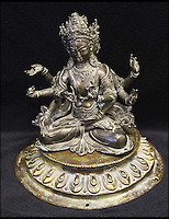 BNPS.co.uk (01202 558833)<br /> Pic: HAldridge/BNPS<br /> <br /> The Tibetan bronze deities that were left at home.<br /> <br /> A man who took an old silver teapot along to TV's Flog It is celebrating today after it led to a record 140,000 pounds sale.<br /> <br /> Experts on the BBC show valued the item, that originated from the Far East, at 120 pounds, prompting the owner to reveal he had five other heirlooms at home.<br /> <br /> After digging the relics out he sold them at auction for the six figure sum, setting a record for the highest amount ever achieved on the popular programme.<br /> <br /> The show is very much like the Antiques Roadshow except that people go on to sell their treasures at auction which is also filmed by the Beeb.<br /> <br /> The unnamed owner took the 12ins tall teapot along to a valuation day held last month at Longleat House, Wilts.