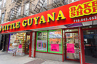 Little Guyana Bake Shop under the elevated train in Richmond Hill in the New York borough of Queens on Thursday, June 25, 2015. The neighborhood of Richmond Hill is a polyglot of ethnic cultures. It is home to Pakistanis, Indians, Guyanese and has a large Sikh population.  (© Richard B. Levine)