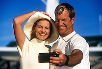 Vacationing couple take a self-portrait.