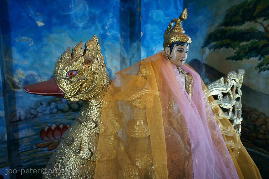 sculpture of a worshipped Nat spirit in Sula Paya pagoda complex, center of Yangon, Myanmar, 2011