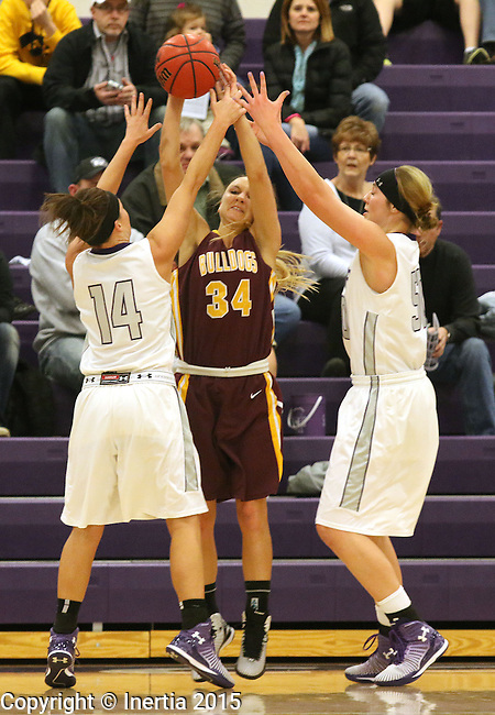 SIOUX FALLS, SD - JANUARY 30:  Jaicee Ulmer #14 and Sam Knecht #50 from the University of Sioux Falls double team Taylor Dillinger #34 from Minnesota Duluth Friday night at the Stewart Center. (Photo by Dave Eggen/Inertia)