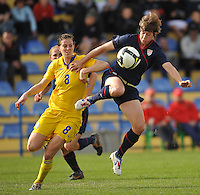 USA player Amy LePeiilbet wins a ball vs Sweden in the 2010 Algarve Cup game played in Ferreiras, Portugal on March 1, 2010.