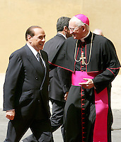 L'arcivescovo americano James Harvey, Prefetto della Casa Pontificia, a destra, accoglie il Presidente del Consiglio Silvio Berlusconi al suo arrivo alla Citta' del Vaticano, 6 giugno 2008, per incontrare il Papa..U.S. archbishop James Harvey, Head of the Papal Household, right, welcomes the Italian Premier Silvio Berlusconi at his arrival at the Vatican, 6 june 2008, to meet the Pope..UPDATE IMAGES PRESS/Riccardo De Luca