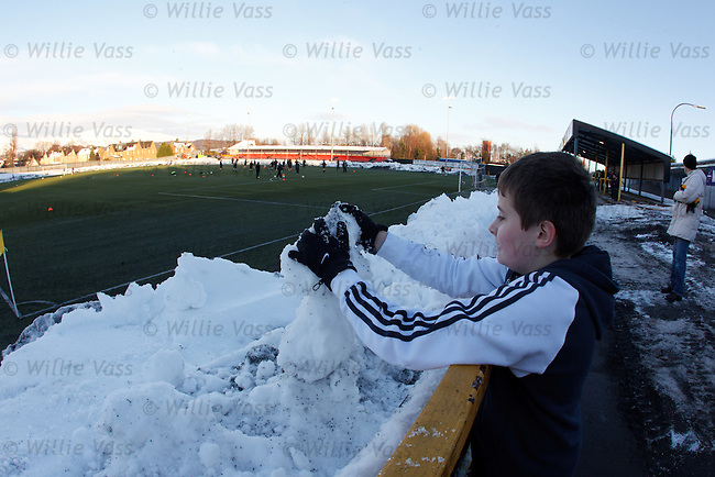 A young Alloa fan building a snowman