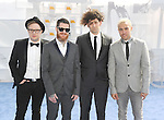 LOS ANGELES, CA - APRIL 12: (L-R) Musicians Patrick Stump, Andy Hurley, Joe Trohman, and Pete Wentz of Fall Out Boy arrive at the 2015 MTV Movie Awards at Nokia Theatre L.A. Live on April 12, 2015 in Los Angeles, California.