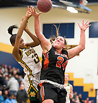 WATERBURY,  CT-021819JS20-  Holy Cross' Cayla Howard (23) is fouled by Watertown's Emily Deptula (24) while driving to the basket during their NVL semi-final game Monday at Kennedy High School in Waterbury. <br /> Jim Shannon Republican American