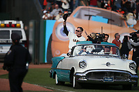 SAN FRANCISCO, CA - SEPTEMBER 29:  Retiring manager Bruce Bochy #15 of the San Francisco Giants waves to the fans from an old car with his wife Kim during a ceremony celebrating his career after the game between the Los Angeles Dodgers and the San Francisco Giants at Oracle Park on Sunday, September 29, 2019 in San Francisco, California.  (Photo by Brad Mangin)