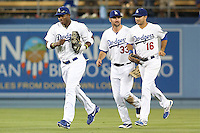 06/06/13 Los Angeles, CA: Los Angeles Dodgers right fielder Yasiel Puig #66,left fielder Scott Van Slyke #33 andLos Angeles Dodgers centerfielder Andre Ethier #16 do a victory jump after the Dodgers defeated the Braves 5-0.