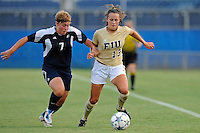 27 August 2011:  FIU's Marie Egan (13) battles Akron's Ashley Hughes (7) for the ball in the first half as the FIU Golden Panthers defeated the University of Arkon Zips, 1-0, at University Park Stadium in Miami, Florida.