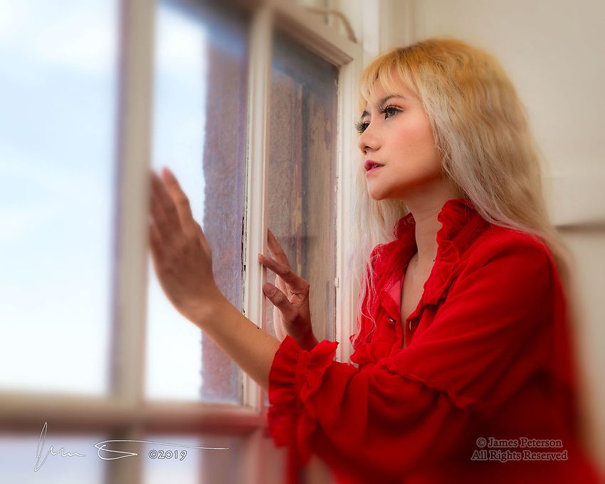 Waiting/Watching.  One can't help but wonder what Yuni is looking for as she gazes across the mountainside town of Jerome, Arizona.  This photo was captured at Red Bench Studio in the Jerome Art Center.<br />
