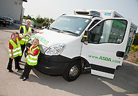 Six year olds Savanna Tate (left) and Savanah Ibbeson together with Community Champion Pat Greenwood and the ASDA delivery van they named