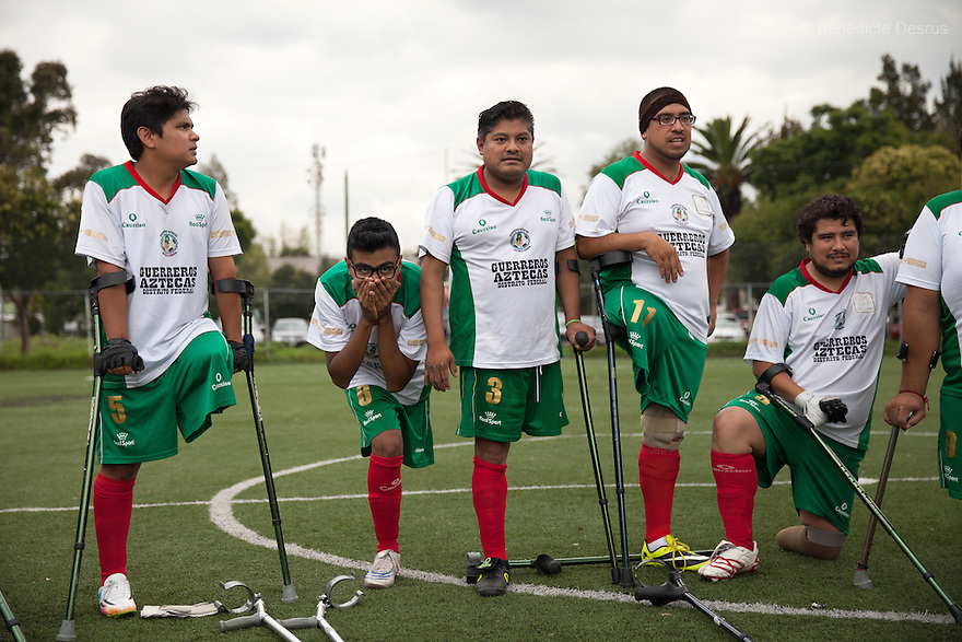 """Players from Guerreros Aztecas watch a penalty shootout during a soccer game with Los Dragones (""""the Dragons"""") in Mexico City, Mexico on July 5, 2014. Guerreros Aztecas (""""Aztec Warriors"""") is Mexico City's first amputee football team. Founded in July 2013 by five volunteers, they now have 23 players, seven of them have made the national team's shortlist to represent Mexico at this year's Amputee Soccer World Cup in Sinaloathis December.The team trains twice a week for weekend games with other teams. No prostheses are used, so field players missing a lower extremity can only play using crutches. Those missing an upper extremity play as goalkeepers. The teams play six per side with unlimited substitutions. Each half lasts 25 minutes. The causes of the amputations range from accidents to medical interventions – none of which have stopped the Guerreros Aztecas from continuing to play. The players' age, backgrounds and professions cover the full sweep of Mexican society, and they are united by the will to keep their heads held high in a country where discrimination against the disabled remains widespread.(Photo byBénédicte Desrus)"""