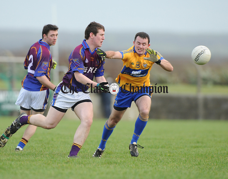 Donagh O Sullivan of U.L. in action against David Tubridy of Clare  during their Mc Grath Cup match at Doonbeg. Photograph by John Kelly.