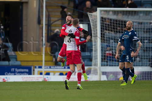 30th November 2019; Dens Park, Dundee, Scotland; Scottish Championship Football, Dundee Football Club versus Queen of the South; Stephen Dobbie of Queen of the South celebrates after scoring for 1-0 with Kevin Holt  - Editorial Use
