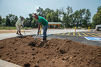 NWA Democrat-Gazette/ANTHONY REYES &bull; @NWATONYR<br /> David Rivera, right, and Marco Bayona, both with Boulder Construction, fill dirt next Monday, Aug. 31, 2015 for a bioswale next to the parking lot near Lake Springdale. Bioswales are designed to remove silt and pollution from surface runoff water. The lot features tails to nearby features, a pavilion and a pair of mountain bike skill courses. The nearly completed lot provides access to the Razorback Greenway, Lake Springdale and eventually a large mountain bike area west of the lot. According to crews on site, the lot should be completed and opened by this weekend.