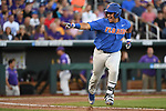 OMAHA, NE - JUNE 26: Austin Langworthy (44) of the University of Florida points to his teammates and smiles after hitting a double during the Division I Men's Baseball Championship held at TD Ameritrade Park on June 26, 2017 in Omaha, Nebraska. The University of Florida defeated Louisiana State University 4-3 in game one of the best of three series. (Photo by Jamie Schwaberow/NCAA Photos via Getty Images)