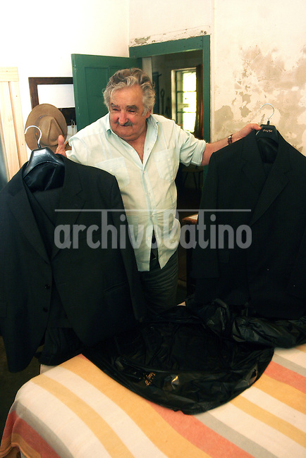 Jose Pepe Mujica, elect President of Uruguay, shows the only two suits of his property and the ones he will use as head of State of this South American property. A former guerrilla leader in the 70s, Mujica leaves in a farm near Montevideo. He won the run of as candidate of the leftist Broad Front.