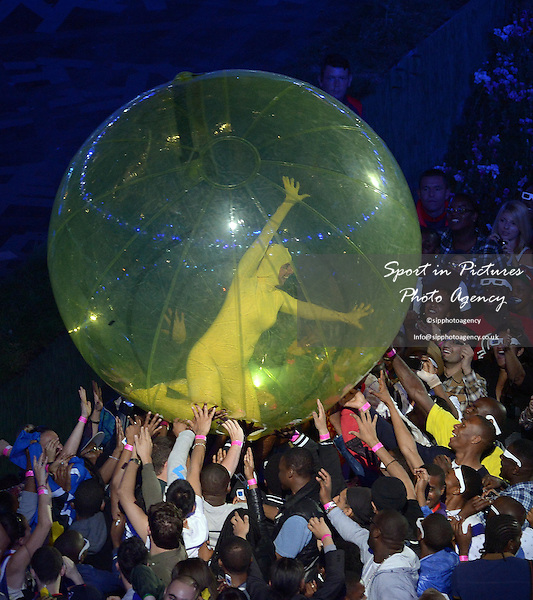 A ball with someone inside is passed around the audience  - PHOTO: Mandatory by-line: Garry Bowden/SIP/Pinnacle - Photo Agency UK Tel: +44(0)1363 881025 - Mobile:0797 1270 681 - VAT Reg No: 768 6958 48 - 27/07/2012 - 2012 Olympics - Opening Ceremony, Olympic Stadium, Olympic Park, Stratford, London, England