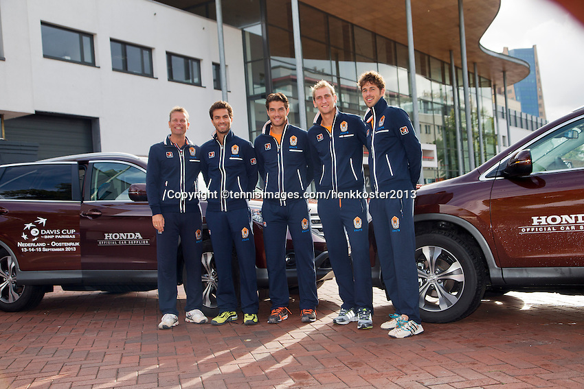 10-09-2013,Netherlands, Groningen,  Martini Plaza, Tennis, DavisCup Netherlands-Austria, Training,  Dutch Team with official cars, ltr: Captain Jan Siemerink, Jean-Julien Rojer, Jesse Huta Galung, Thiemo de Bakker and Robin Haase.<br /> Photo: Henk Koster