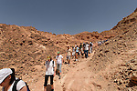 Israel, Eilat Mountains. Hikers in Wadi Yoash