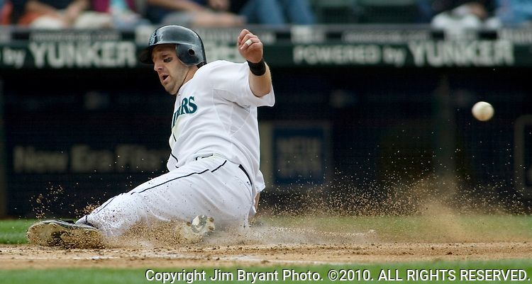 Seattle Mariners' Willie Bloomquist slides into home on a RBI double hit by Yuniesky Betancourt in the third inning of Major League Baseball game in Seattle on Sunday, July 6, 2008.  Jim Bryant Photo. ©2010. ALL RIGHTS RESERVED.
