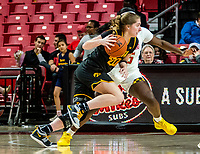 COLLEGE PARK, MD - FEBRUARY 13: Kate Martin #20 of Iowa goes past Ashley Owusu #15 of Maryland during a game between Iowa and Maryland at Xfinity Center on February 13, 2020 in College Park, Maryland.