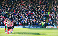 Lincoln City players and fans during a minutes applause in memory of Gordon Banks<br /> <br /> Photographer Chris Vaughan/CameraSport<br /> <br /> The EFL Sky Bet League Two - Lincoln City v Stevenage - Saturday 16th February 2019 - Sincil Bank - Lincoln<br /> <br /> World Copyright © 2019 CameraSport. All rights reserved. 43 Linden Ave. Countesthorpe. Leicester. England. LE8 5PG - Tel: +44 (0) 116 277 4147 - admin@camerasport.com - www.camerasport.com