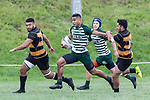 Pisi Leilua makes a break between Abel Enosa-Taifau and Mitchell Tukerangi. Counties Manukau Premier Counties Power Club Rugby Round 4 game between Bombay and Manurewa, played at Bombay on Saturday March 31st 2018. <br /> Manurewa won the game 25 - 17 after trailing 15 - 17 at halftime.<br /> Bombay 17 - Ki Anufe, Chay Macwood tries, Tim Cossens, Ki Anufe conversions,  Ki Anufe penalty. <br /> Manurewa Kidd Contracting 25 - Peter White 2 , Willie Tuala 2 tries, James Faiva conversion,  James Faiva penalty.<br /> Photo by Richard Spranger.