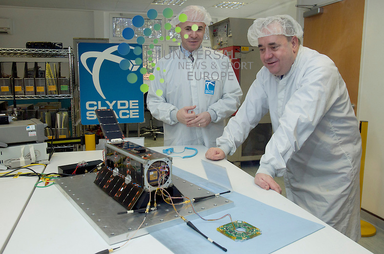 Clyde Space CEO Craig Clark with Scotland's first minister Alex Salmond both looking at the new cubesat system.The company which designed and built Scotland's first satellite is set to expand after securing two orders worth a total of more than &pound;2m.<br /> Glasgow-based Clyde Space will provide power systems for Luxembourg-based space company Lux Space in a deal valued at &pound;1.2m.<br /> The systems will be used in two satellites Lux is building for the European Space Agency.<br /> The second deal, worth nearly &pound;1m, involves US-based Spire Inc.<br /> Clyde Space, which produces small satellite, nanosatellite and CubeSat systems, built the UKube-1 which was launched into space from Kazakhstan in July.<br /> It is also currently working on what it claims is the most advanced CubeSat ever built for the Belgian Institute for Space Aeronomy.<br /> Clyde Space founder and chief executive Craig Clark said: &quot;Our first satellite UKube-1 allowed us not only to prove a bunch of new technologies in space, it also puts us on the map as a proven spacecraft provider not just in the UK, but globally.<br /> &quot;We're building on this experience and success to deliver even more capable spacecraft.&quot;<br /> Picture: Universal News And Sport (Europe) 27 October 2014.