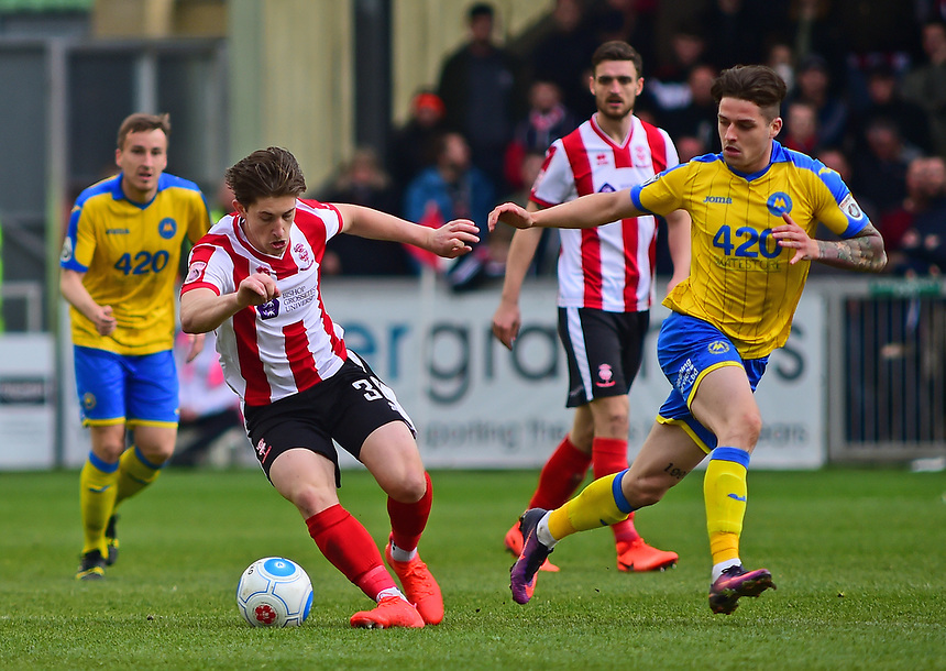 Lincoln City's Alex Woodyard turns away from Torquay United's Ruairi Keating<br /> <br /> Photographer Andrew Vaughan/CameraSport<br /> <br /> Vanarama National League - Lincoln City v Chester - Tuesday 11th April 2017 - Sincil Bank - Lincoln<br /> <br /> World Copyright &copy; 2017 CameraSport. All rights reserved. 43 Linden Ave. Countesthorpe. Leicester. England. LE8 5PG - Tel: +44 (0) 116 277 4147 - admin@camerasport.com - www.camerasport.com