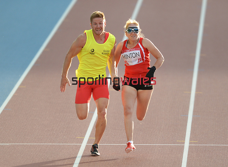 Wales Tracey Hinton with guide runner Steffan Hughes<br /> <br /> Photographer Ian Cook/Sportingwales<br /> <br /> 20th Commonwealth Games - Athletics  -  Day 5 - Monday 28th July 2014 - Glasgow - UK