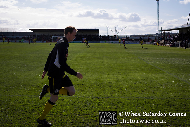 Arbroath 0 Edinburgh City 1, 15/03/2017. Gayfield Park, SPFL League 2. Away substitute Ross Guthrie warming up during the second-half at Gayfield Park as Arbroath hosted Edinburgh City (in yellow) in an SPFL League 2 fixture. The newly-promoted side from the Capital were looking to secure their place in SPFL League 2 after promotion from the Lowland League the previous season. They won the match 1-0 with an injury time goal watched by 775 spectators to keep them 4 points clear of bottom spot with three further games to play. Photo by Colin McPherson.