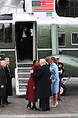 Former United States President Barack Obama and Michelle Obama speak with US President Donald Trump and Melania Trump in front of Marine One on the East front as Obama departs from the 2017 Presidential Inauguration at the US Capitol in Washington, DC on January 20, 2017.<br /> Credit: Jack Gruber / Pool via CNP