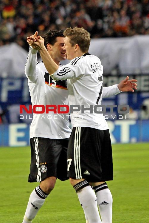 L&permil;nderspiel<br /> WM 2010 Qualifikatonsspiel Qualificationmatch Leipzig 28.03.2009 Zentralstadion Gruppe 4 Group Four <br /> <br /> Deutschland ( GER ) - Liechtenstein ( LIS )<br /> <br /> Michael Ballack (#13 FC Chelsea London Deutsche Nationalmannschaft) und Bastian Schweinsteiger (#7 Bayern M&cedil;nchen Deutsche Nationalmannschaft) jubeln nch dem 1:0.<br /> <br /> Foto &copy; nph (  nordphoto  )<br />  *** Local Caption ***