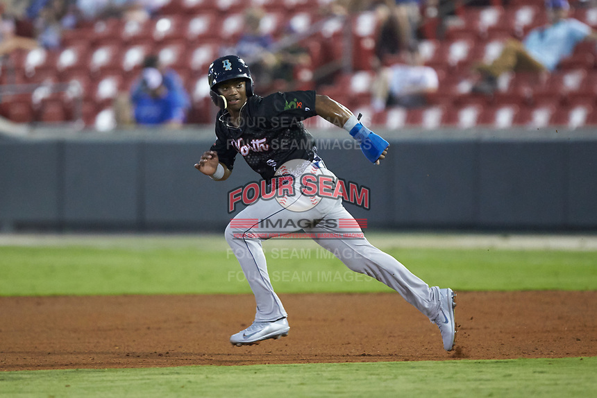 Khalil Lee (20) of the Wilmington Blue Rocks takes off for second base during the 2018 Carolina League All-Star Classic at Five County Stadium on June 19, 2018 in Zebulon, North Carolina. The South All-Stars defeated the North All-Stars 7-6.  (Brian Westerholt/Four Seam Images)